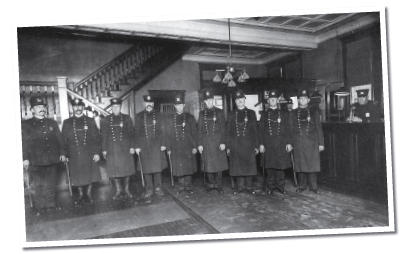 Officers pose in the District 3 roll call room in District Three, Cincinnati, in 1907