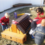 Students and a teacher investigate the Toddler Music Station at A to Z Child Care in American Fork, Utah, last winter.
