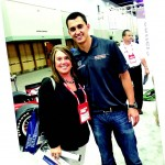 Account Executive Christi Sausaman with Indy car driver Graham Rahal at the Holmatro exhibit.