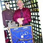 Sheriff David Lain of Porter County, Ind., owns an extensive assortment of police antiquities that includes the handcuffs, come-alongs and leg chains pictured. He's acquired them over the last 23 years through his own investigation and from friends. (Photo by Dee Dunheim)