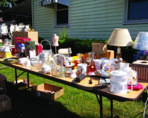 Community leaders can help foster an attitude for reuse by paving the way for residents to sell their goods at yard sales.