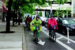 Bicyclists take to the Kinzie Street green lane in Chicago