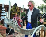 Sedona, Ariz., Mayor Rob Adams plays the opening notes of an inaugural concert performed on Freenotes outdoor instruments