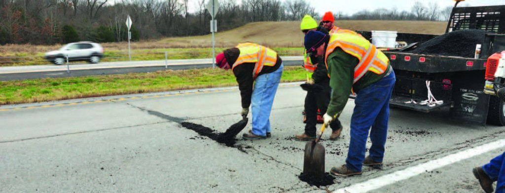 Members of the Lexington, Ky., Streets and Roads Department apply cold mix for an evaluation program