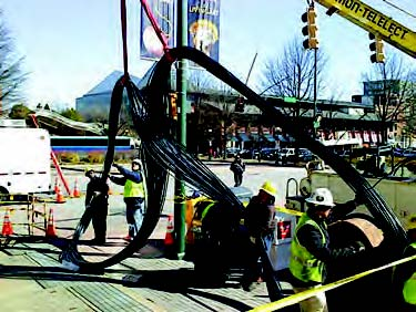 EPB crews install bundled fiber optic cables in downtown Chattanooga.