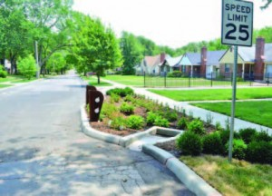 addition of curbs, sidewalks, porous sidewalks, rain gardens and curb extensions