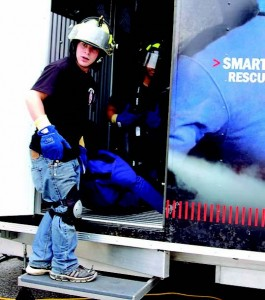 From left, Mitch Latta and Donivon Brummett exit a trailer at FDIC after retrieving their Smartdummy Rescue Manikin from a heavy smoke environment. The high school students attended the 2012 conference in Indianapolis as part of their Firefighting 1 and 2 studies. (Photo by Jodi Magallanes)