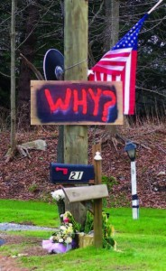 Signs of shock and sadness sprang up instantly across the small New England town and throughout the country for the Newtown victims. (Gina Jacobs/Shutterstock)