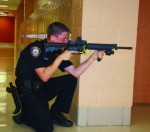 Officer Elliott Pedersen stands ready for action during the rapid deployment practice event in Plainfield, Ill.
