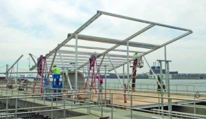 For the Camden project, modified carport racking was used to suspend the photovoltaic modules over the wastewater treatment tanks, providing a creative means of using space that had no other purpose. (Provided by groSolar)