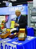 Charles Warner of Warner Plastics and Liners demonstrates the quality of the company's dump truck liners at the 2013 Work Truck Show