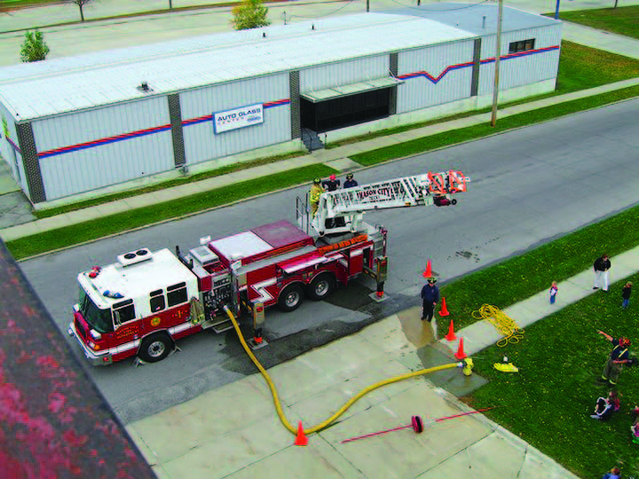 Mason City Fire Department, Iowa, gives a demonstration with their quint. The quint's major benefit to the department has been providing flexibility when the department is short-staffed.