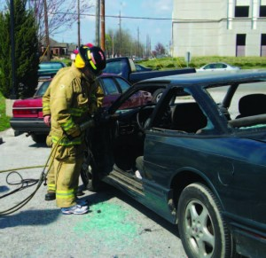 Springfield, Mo., CAmP participants use the Jaws of Life during the fire department's program day. CAmP is designed to give city employees a better understanding on how the city operates.