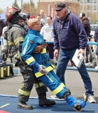 "part of the Scott Firefighter Combat Challenge was the rescue of a 175-pound ""victim."" Thomas Gies, Merrick FDNYC, pictured, won his early heat."