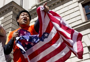 A man waves an American flag in honor of Boston Marathon