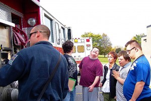 "As autistic people become more comfortable with emergency personnel and equipment, they will approach them, which calms intimidation factors. This training took place at the Mundelein, Ill., Fire Department's ""Truck Talk"" event. (Photo provided)"