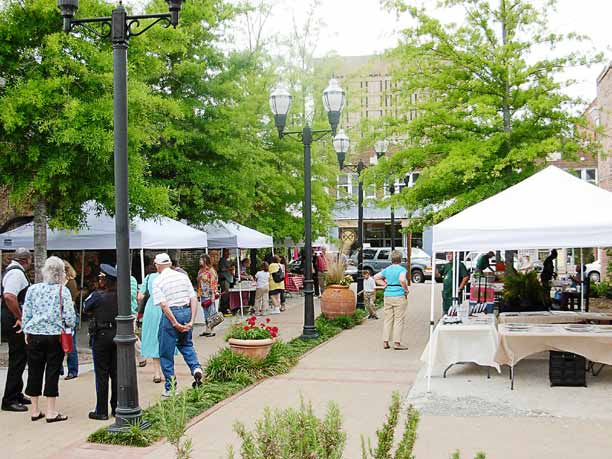 Residents of Florence, S.C., gather every Wednesday from April to October in downtown Florence to shop at a farmers' market.