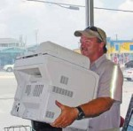 After two years of practice, employees of Atlantic Beach, N.C., have the protocols for recycling and buying green down. Recently, the town clerk's printer went bad and employees used EPEAT comprehensive environmental ratings to purchase a new one through a register recycler. The photo shows Richard Lee hauling the old printer off to recycling. (Photo provided)