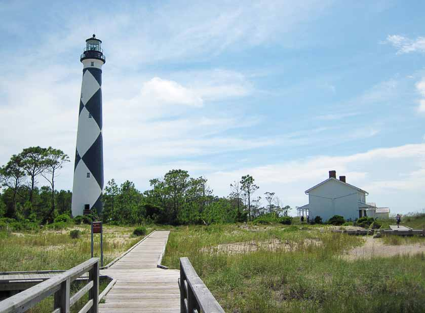 The lighthouse at Cape Lookout National Seashore, North Carolina, is maintained by National Park Service park rangers. The park's Keepers' Quarters Museum is on the right. (Photo provided)