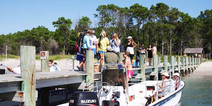 Visitors board a ferry to Cape Lookout, an island under the jurisdiction of the National Park Service. General maintenance on the island is done by federal employees while the lighthouse's light is maintained by the U.S. Coast Guard. (Photo provided)