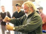 Another method of testing biodiesel fuel is the 3/27 test to gauge the quantity of glycerides — unconverted feedstock — that might be present in the fuel. The photo shows Rich Cregar checking a sample for glycerin for two of his biofuel technology students, Robert Harkins and Richard Sosnowski. (Photo provided)