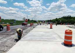 "The depiction above is part of a Kentucky project and shows the best practice of using concrete at signalized intersections to prevent the rutting and ""washboarding"" that occurs when heavy vehicles stop or sit for prolonged periods. (Photo provided)"