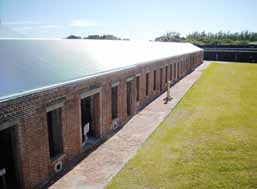 Deteriorated rainwater pipes at the barracks building of Fort Zachary Taylor had dampened the structure's walls — prompting the search for a repair solution.