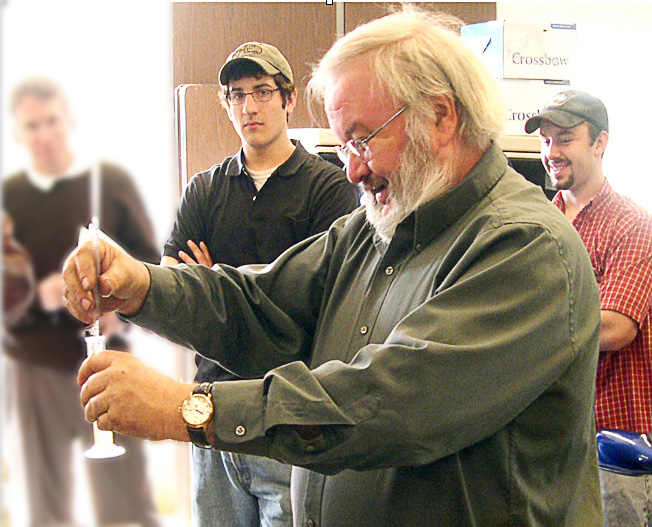 One method of testing biodiesel fuel is the 3/27 test, which gauges the quantity of glycerides — unconverted feedstock — that might be present in the fuel. The photo shows Wilson Community College professor Rich Cregar checking a sample for his biofuel technology students. (Photo provided)