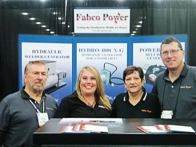 The Municipal Account Executive Christi Sausaman, second from left, stopped by Fabco Power's booth at icuee 2013, which took place in Louisville, Ky., Oct. 1–3. From left are Bob Fury of Fabco; Sausaman; and Terry Moon and Arty Andersen of Fabco. (Photo provided)