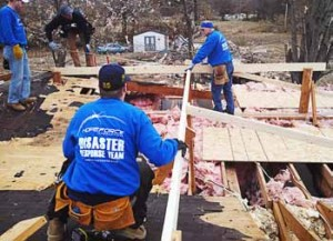 Hope Force volunteers Phillip Vork, foreground, and from left, Anthony Shows, Joey Stoltzfus and Tom Wilson repair a roof damaged by the tornado that struck Brookport. (Photo provided by Hope Force)