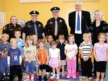 From left, Berrien County Sheriff's Deputy Kelly Laesch, Chief Milton Agay, Berrien County Sheriff Paul Bailey and former Berrien County Prosecutor Arthur Cotter, now a judge, spent a day recently at Witheral School Day Care in St. Joseph, Mich. (Photo provided)