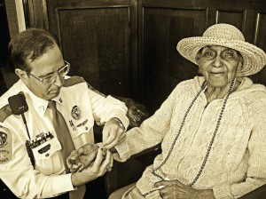 Project Lifesaver International Chief Operating Officer Tommy Carter does a monthly battery/bracelet change for a client. She wears a watch-sized transmitter. (Photo provided)