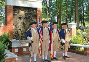 "The Roswell, Ga., color guard stands at the Faces of War Memorial. The city hosts ""Roswell Remembers"" each year, a celebration that draws in excess of 6,000 people, making it the largest Memorial Day ceremony in Georgia. (Photo courtesy of Roswell Recreation, Parks, Historic and Cultural Affairs Dept.)"