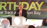 Jacobsen President David Withers speaks to attendees of the Earth Day event at The Bear Trace at Harrison Bay.