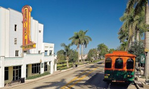 The National Park Trolley ambles past Seminole Theater in Homeland, Fla.'s downtown historical district. The theater, built in 1921, was rebuilt in 1940 following a devastating fire. After its second near-destruction by Hurricane Andrew, the theater closed its doors in 1979. The exterior was recently renovated and the interior work awaits funding.