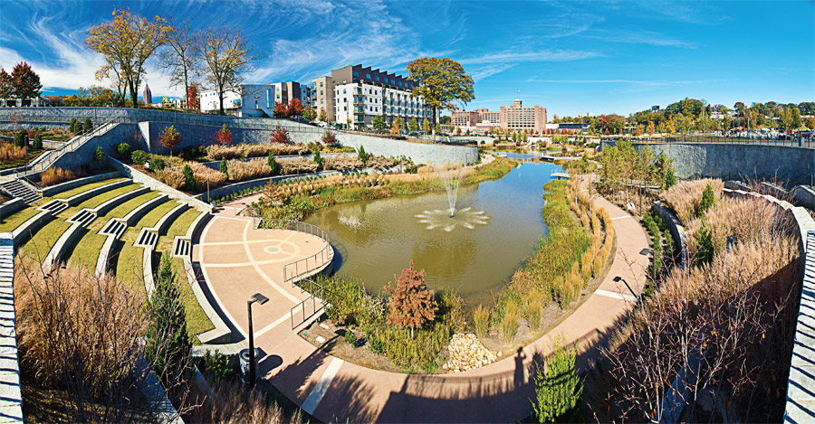Incorporating the existing waterway, historic Fourth Ward Park in Atlanta, Ga., offers an enticing respite of natural beauty beneath the nearby towering urban edifices. Included in the oasis are a variety of decorative vegetation, a fountain, bike paths, walkways and an amphitheater. (Photo provided)