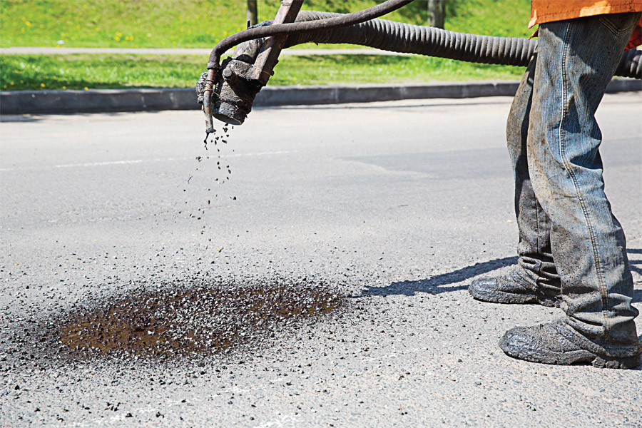 As public works departments struggle to stretch their budgets far enough to be able to patch all of their pothole-plagued streets, in a few instances residents have decided to take matters into their own hands and attempt the repairs on their own. (Shutterstock photo)