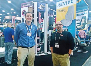 """The Road Ahead Begins at mats"" was the theme of the 43rd annual Mid-America Trucking Show in Louisville, Ky. Pictured, from left, are Daniel Lewis of Commercial Vehicle Group Inc. and The Municipal Account Executive Chris Smith on the show floor. (Photo by Ashley Adamaitis)"