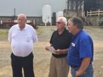 The Godwin Group founder Pat Godwin Sr., (white shirt) Architect Joseph Sekely III (black shirt), and Galion-Godwin general manager Carl Wilson (blue shirt), discussing construction.