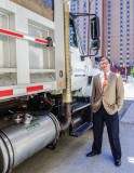 Grant Ervin, sustainability manager for the city of Pittsburgh, next to a truck fitted with Optimus Technologies' renewable diesel solution.