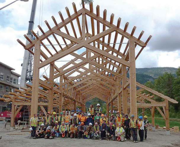 A group photo takes place following completion of the frame of a Pemberton, British Columbia. The open-air venue made entirely from locally harvested timber and constructed by the Timber Framers Guild, in conjunction with local volunteers. (Photo provided)