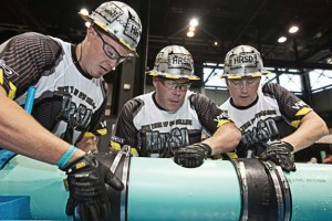 "Team members in a 2013 weftec Operations Challenge simulate a repair to a wastewater collection system. The challenge is part of the annual weftec conference, ""the largest water quality conference in the world."" (Photo: weftec.org)"