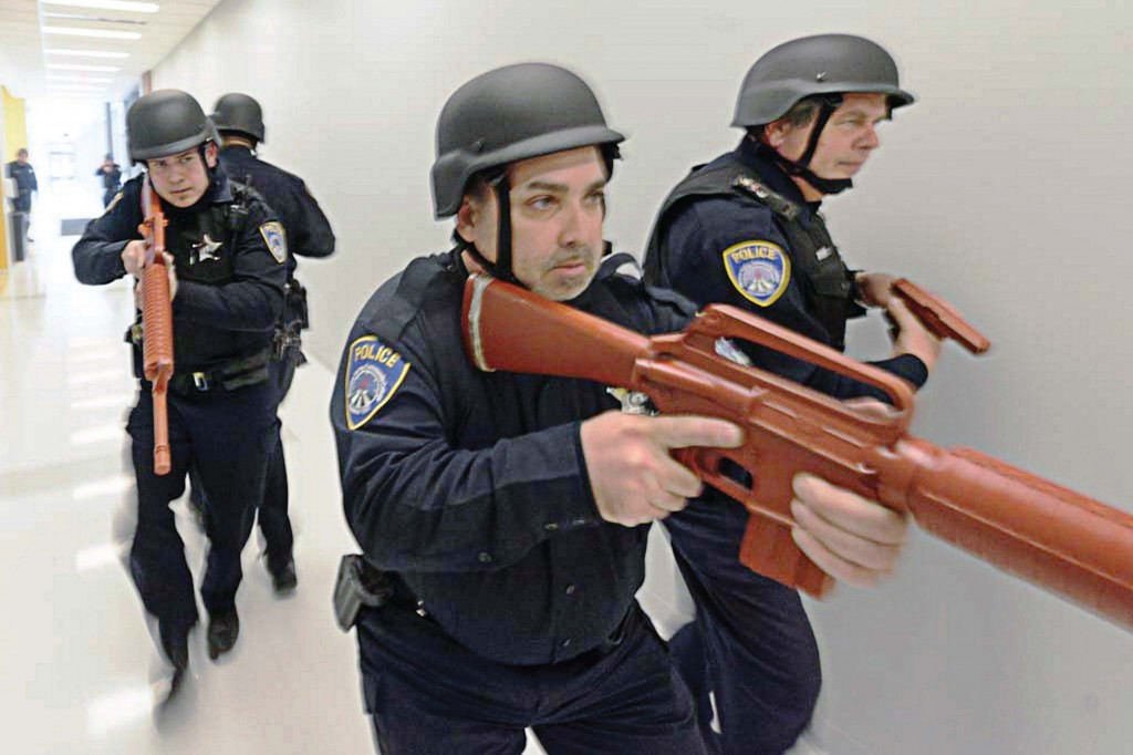 Officers conduct an active shooter response drill at Moraine Valley Community College in Illinois. Over the years school shootings have been committed by individuals who cross age, race, gender and economic boundaries, so developing the relationships that render information on individuals with violent indicators is the most successful tactic for heading off such incidents. (Photo provided)