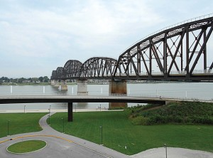 The Louisville side of the Big Four Bridge, pictured, opened in 2013. Since the opening of the Indiana-side ramp this year, walkers and bikers can now not only cross the Ohio River on the bridge but continue into downtown Jeffersonville to eat or shop. (Photo by Diana Likens)