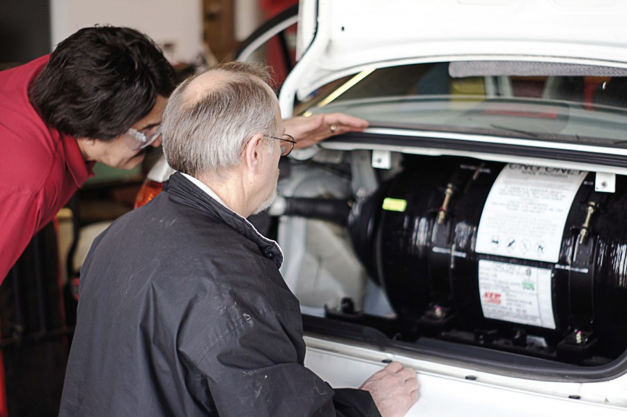 Technicians complete a natural gas cylinder check. Training is extremely important prior to the first alternative fuel vehicle arrival, since it builds technicians' confidence. (Photo provided)