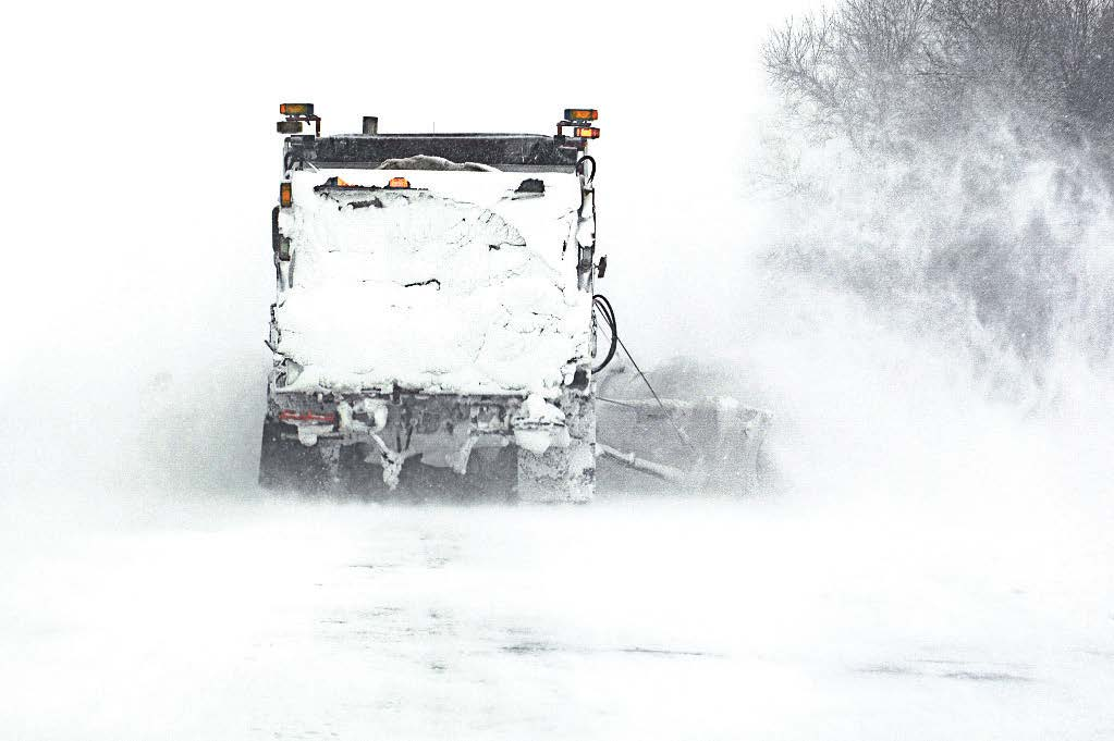 Severe winter storm events mean limited visibility and poor driving conditions, making motorists on the roadway a dangerous combination that can impede recovery efforts. Above, a Minnesota Department of Transportation snowplow truck works to clear a road