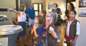 Ashley Carver, Morton Museum of Collierville history director, gives a local Girl Scout troop a tour