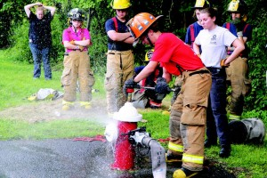 Fire service training programs also attract female would-be firefighters. Some of his most enthusiastic youth program members are girls, said fasny Youth Committee Chairman Jerry Presta. (Photo provided)
