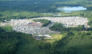 The former county fairgrounds just north of Rhinelander are jammed with more than 50,000 visitors during the nine-day Hodag Country Festival, held each July. Millions of dollars pour into the community and the surrounding area during the event, which centers around a disproved legend. (Photo provided)
