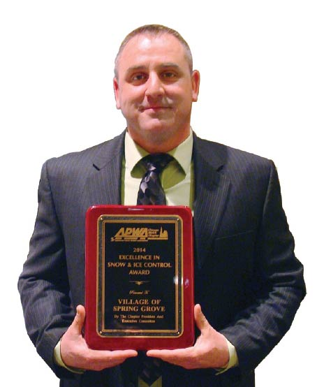 Matt Wittum, supervisor, Spring Grove Public Works Department, receives the Excellence in Snow and Ice Control Award from the Metro Chapter of the American Public Works Association last year.